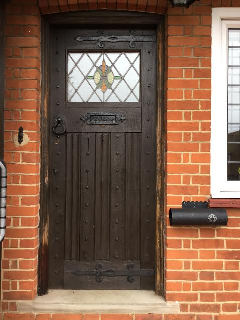 "Colin from Hitchin ""I thought you might be interested to see how I used the piece of leaded stained glass I recently purchased from you. The oak door is original to the house and dates from 1926 and I have removed the top section of the door to let in the leaded light. The hall is now much less gloomy. I attached the stained glass to a frosted glass double glazed panel using bathroom translucent sealant before installing using offcuts from the bit of door I removed and sealant."""